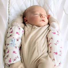 baby-asleep-in-Amby-sleep-positioner